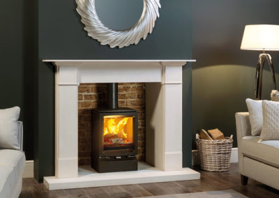 Stovax-Vogue-Midi-woodburning-with-Plinth-and-Claremont-Limestone-Mantel-mi